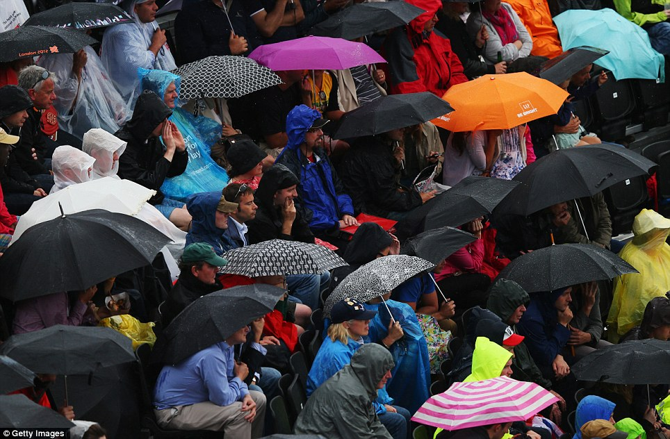 Not beach weather: Umbrellas were up in force to protect spectators from the rain at the beach volleyball in Horse Guards Parade