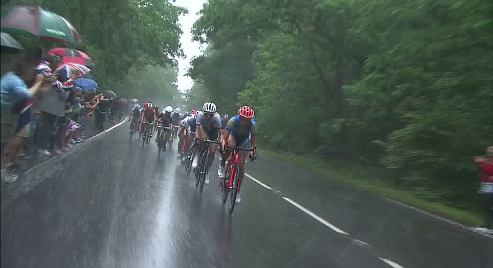 Peddle power: The rain lashed down on the women road cyclists who competed during the downpour which stopped other Olympic sports