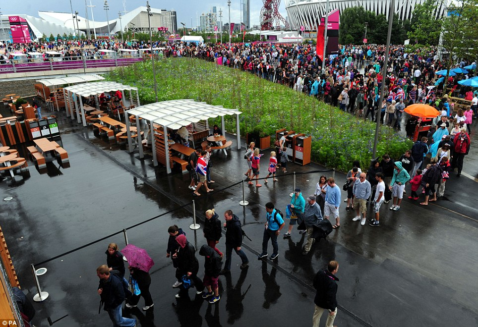Hundreds of people fled to McDonald's in the Olympic Park to shelter from the rain which stopped the tennis and delayed other events