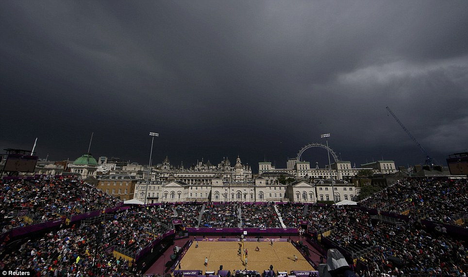 Take cover: The heavens look ready to open above the beach volleyball stadium at Horses Guards Parade