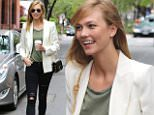 New York, NY - Model, Karlie Kloss, turns NYC streets into her personal photo shoot as she is spotted running errands with a friend in crutches.\nAKM-GSI      May 4, 2016\nTo License These Photos, Please Contact :\nSteve Ginsburg\n(310) 505-8447\n(323) 423-9397\nsteve@akmgsi.com\nsales@akmgsi.com\nor\nMaria Buda\n(917) 242-1505\nmbuda@akmgsi.com\nginsburgspalyinc@gmail.com