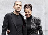 """U.S. singer Janet Jackson (R) and her then boyfriend Wissam Al Mana pose for photographers as they arrive to attend the Giorgio Armani Autumn/Winter 2013 collection at Milan Fashion Week, in this file picture taken February 25, 2013.  Hinting at a possible pregnancy, Janet Jackson announced on April 6, 2016 that she was temporarily halting her world tour because of a """"sudden change"""" that required her and her husband to plan a family.     REUTERS/Alessandro Garofalo/Files"""