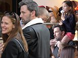 """EXCLUSIVE Jennifer Garner and Ben Affleck are back together. Jen and Ben and their 3 children, Violet, Seraphina and Samuel arrived incognito in Paris and stayed in a luxurious hotel. On Thursday afternoon, they left their hotel for a stroll in the streets of Paris. They went to the famous icecream shop """"Amorino"""" where they queued like anybody else. They were straight away recognised by some clients and they even chatted with them. They were seeing kissing each other after returning to their hotel, said an eye witness inside the hotel. Later on, Jennifer left the hotel to buy some take away pizza to eat in the hotel.  6 May 2016. Please byline: Vantagenews.com UK clients should be aware children's faces may need pixelating."""