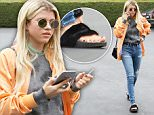 West Hollywood, CA - Sofia Richie keeps it casual for an outing at Fred Segal. The 17-year-old model is wearing ripped jeans and a grey tee paired with a bright orange bomber jacket and Rihanna x Puma Fenty Fur Slides. \n  \nAKM-GSI       May 5, 2016\nTo License These Photos, Please Contact :\nSteve Ginsburg\n(310) 505-8447\n(323) 423-9397\nsteve@akmgsi.com\nsales@akmgsi.com\nor\nMaria Buda\n(917) 242-1505\nmbuda@akmgsi.com\nginsburgspalyinc@gmail.com