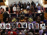 Photographs of the nine victims killed at the Emanuel African Methodist Episcopal Church in Charleston, South Carolina are held up by congregants during a prayer vigil at the the Metropolitan AME Church on June 19 in Washington, DC. Dylann Roof   Read more: http://www.dailymail.co.uk/news/article-3181076/Suspect-Charleston-church-shooting-federal-court.html#ixzz480WPmbOo  Follow us: @MailOnline on Twitter | DailyMail on Facebook