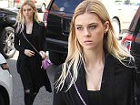 Beverly Hills, CA - 'Bates Motel' actress Nicola Peltz looks sultry in all black as she struts down the street wearing a black long coat, black top, black ripped jeans, black boots, and a bright purple Chanel crossover bag.\nAKM-GSI         May 6, 2016\nTo License These Photos, Please Contact :\nSteve Ginsburg\n(310) 505-8447\n(323) 423-9397\nsteve@akmgsi.com\nsales@akmgsi.com\nor\nMaria Buda\n(917) 242-1505\nmbuda@akmgsi.com\nginsburgspalyinc@gmail.com