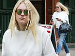 eURN: AD*205141062  Headline: Dakota Fanning picks a winner while waiting at the light Caption: New York, NY - Dakota Fanning cleans out her nose as she waits for the crosswalk light to change while on a coffee run in Soho, New York. Dakota was spotted picking her nose and rolling up her results in her fingers as she crossed the street on the way to a coffeehouse.   AKM-GSI  May  5, 2016 To License These Photos, Please Contact : Steve Ginsburg (310) 505-8447 (323) 423-9397 steve@akmgsi.com sales@akmgsi.com or Maria Buda (917) 242-1505 mbuda@akmgsi.com ginsburgspalyinc@gmail.com Photographer: EBAS  Loaded on 05/05/2016 at 18:21 Copyright:  Provider: AKM-GSI  Properties: RGB JPEG Image (19997K 2545K 7.9:1) 2133w x 3200h at 300 x 300 dpi  Routing: DM News : GeneralFeed (Miscellaneous) DM Showbiz : SHOWBIZ (Miscellaneous) DM Online : Online Previews (Miscellaneous), CMS Out (Miscellaneous)  Parking: