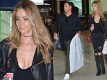 EXCLUSIVE - Jennifer Hawkins & Jake Wall at Sydney Airport, believed to be headed to Melbourne for the Logies. May 7, 2016