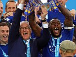 LEICESTER, ENGLAND - MAY 07:  Wes Morgan and Manager/Head Coach of Leicester City Claudio Rainieri lift the Premier League Trophy as Leicester City celebrate becoming Premier League Champions for the 2015/16 Season at the end of the Barclays Premier League match between Leicester City and Everton at The King Power Stadium on May 7, 2016 in Leicester, United Kingdom.  (Photo by Matthew Ashton - AMA/Getty Images)