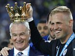 """Britain Soccer Football - Leicester City v Everton - Barclays Premier League - King Power Stadium - 7/5/16  Leicester City manager Claudio Ranieri lifts the trophy with Kasper Schmeichel as they celebrate winning the Barclays Premier League  Action Images via Reuters / Carl Recine  Livepic  EDITORIAL USE ONLY. No use with unauthorized audio, video, data, fixture lists, club/league logos or """"live"""" services. Online in-match use limited to 45 images, no video emulation. No use in betting, games or single club/league/player publications.  Please contact your account representative for further details."""