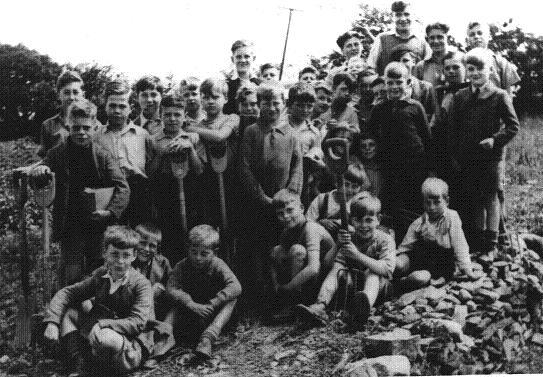 Evacuated in 1940, pupils from St Martins School are pictured at Pengeham, South Wales, during World War II