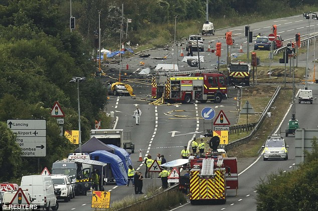Police warned that the death toll was expected to rise from 11. Pictured, emergency services at the scene