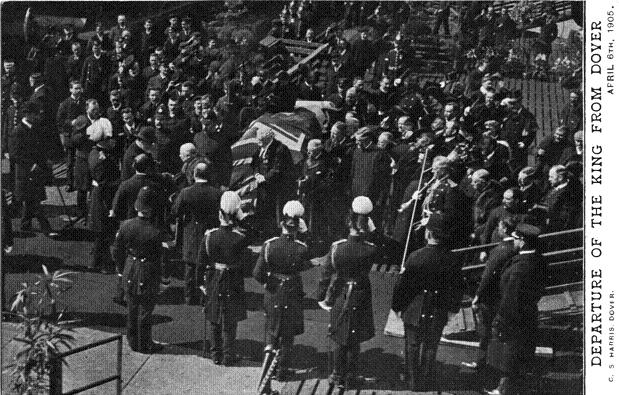 Picture shows King Edward VII shaking hands with a VIP, at the dockside