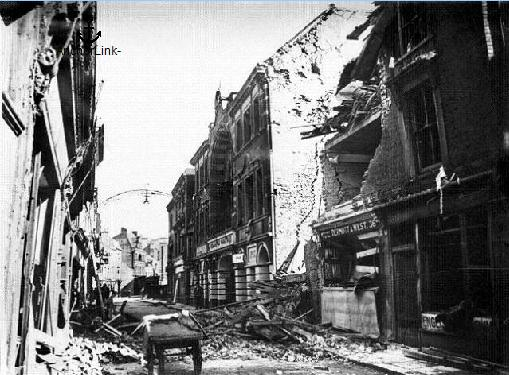 Extensive damage to Snargate Street including the Hippodrome Theatre, from one of the last shells in World War 2