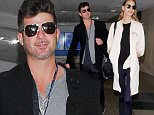 Los Angeles, CA - Lovebirds Robin Thicke, 39, and his model girlfriend April Love Geary, 21 touch down at LAX Airport on Mother's Day. His relationship with ex wife Paula Patton came to an end in 2014 and he moved on with model April Love Geary.\nAKM-GSI      May 8, 2016\nTo License These Photos, Please Contact :\nSteve Ginsburg\n(310) 505-8447\n(323) 423-9397\nsteve@akmgsi.com\nsales@akmgsi.com\nor\nMaria Buda\n(917) 242-1505\nmbuda@akmgsi.com\nginsburgspalyinc@gmail.com