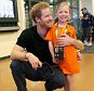 ORLANDO, FL - MAY 07:  Prince Harry has a photo taken with a Dutch girl called Daimy Gommers at Invictus Games Orlando 2016 at ESPN Wide World of Sports on May 7, 2016 in Orlando, Florida. Prince Harry, patron of the  Invictus Games Foundation is in Orlando ahead of the opening of Invictus Games which will open on Sunday. The Invictus Games is the only International sporting event for wounded, injured and sick servicemen and women. Started in 2014 by Prince Harry the Invictus Games uses the power of Sport to inspire recovery and support rehabilitation.  (Photo by Chris Jackson/Getty Images for Invictus)