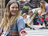 EXCLUSIVE TO INF\nMay 7, 2016: Actress Drew Barrymore is seen out the day before mothers day, enjoying time with her two kids at the park. Drew was seen taking photos of her kids and playing with her children in New York City, New York. \nMandatory Credit: Peter Cepeda/INFphoto.com Ref: infusny-260