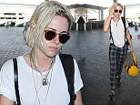 Los Angeles, CA - Kristen Stewart shows off her blonde hairdo while getting ready to catch a departing flight out of LAX. The newly single actress wore a simple white tee with leather suspenders, plaid colored pants and Adidas black sneakers.\nAKM-GSI      May 8, 2016\nTo License These Photos, Please Contact :\nSteve Ginsburg\n(310) 505-8447\n(323) 423-9397\nsteve@akmgsi.com\nsales@akmgsi.com\nor\nMaria Buda\n(917) 242-1505\nmbuda@akmgsi.com\nginsburgspalyinc@gmail.com