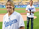 LOS ANGELES, CA - MAY 09:  Singer Keith Urban announces the starting lineup for the Los Angeles Dodgers before the game against the New York Mets at Dodger Stadium on May 09, 2016 in Los Angeles, California.  (Photo by Harry How/Getty Images)