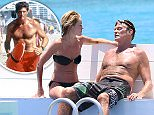EXCLUSIVE: Baywatch star David Hasselhoff and fiancee Hayley Roberts relax on an idyllic Caribbean beach.\nThe Hoff may be claiming financial hardship because of alimony payments to second wife, actress Pamela Bach, but it didn't stop him spending thousands of a romantic vacation in Barbados with his young Welsh girlfriend.\nDespite earning millions from his TV career, court documents have revealed Hasselhoff, 63, owes more than $100,000 in credit card debt and claims each month he's left with virtually no money to live on.\nDespite their 27-year age gap, Hasselhoff and his 36-year-old partner, looked very much in love as they chilled out in the waves. The former Knight Rider actor met Hayley while a judge on Britain's Got Talent. He proposed to her earlier this month after nearly five years of dating.\nHasselhoff's first marriage was to singer Catherine Hickland for five years before they split in 1989. He later tied the knot with Bach, with whom he has two children.\nCredit: SkyBlue