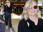 8.May.2016 ñ Los Angeles ñ USA\n*** STRICTLY AVAILABLE FOR UK AND GERMANY USE ONLY ***\nLos Angeles, CA - Kirsten Dunst keeps it trendy while departing LAX in a black top, high waisted denim, white sandals, plaid luggage, and an embroidered handbag.\nBYLINE MUST READ : AKM-GSI-XPOSURE\n***UK CLIENTS - PICTURES CONTAINING CHILDREN PLEASE PIXELATE FACE PRIOR TO PUBLICATION ***\n*UK CLIENTS MUST CALL PRIOR TO TV OR ONLINE USAGE PLEASE TELEPHONE 0208 344 2007*\n