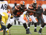 FILE - In this Jan. 3, 2016, file photo, Cleveland Browns offensive tackle Cameron Erving (74) competes against the Pittsburgh Steelers during the second half of an NFL football game in Cleveland. A teenager in Ohio got a treat on prom night: a surprise date with Erving. (AP Photo/Ron Schwane, File)