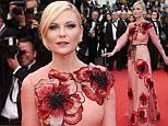 Actress Kirsten Dunst arrives on the red carpet for the screening of the film Cafe Society and the Opening Ceremony at the 69th international film festival, Cannes, southern France, Wednesday, May 11, 2016. (AP Photo/Joel Ryan)
