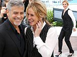 """CANNES, FRANCE - MAY 12:  George Clooney and Julia Roberts attend the """"Money Monster"""" photocall during the 69th annual Cannes Film Festival at the Palais des Festivals on May 12, 2016 in Cannes, France.  (Photo by Venturelli/WireImage)"""