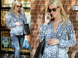 Picture Shows: Nicky Hilton  May 11, 2016\n \n Pregnant socialite, Nicky Hilton, is spotted gently caressing her growing baby bump while taking a stroll in New York City, New York. She looked peacefully happy in her chic printed top, jeans, flats and sunglasses. \n \n Non Exclusive\n UK RIGHTS ONLY\n \n Pictures by : FameFlynet UK © 2016\n Tel : +44 (0)20 3551 5049\n Email : info@fameflynet.uk.com