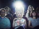 Woman enjoying movie at cinema