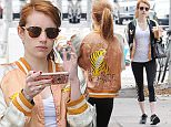 Picture Shows: Emma Roberts  May 11, 2016\n \n Emma Roberts was spotted shopping in Los Angeles, California. She was wearing a cool reversible orange and green jacket with a tiger embroidered on the back.\n \n Non Exclusive\n UK RIGHTS ONLY\n \n Pictures by : FameFlynet UK © 2016\n Tel : +44 (0)20 3551 5049\n Email : info@fameflynet.uk.com