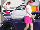 Please contact X17 before any use of these exclusive photos - x17@x17agency.com   Caitlyn Jenner is all smiles, chatting up a mystery man while gassing up her brand new $200K purple Porsche in Malibu, CA. The former Olympian puts on a leggy display in a hot pink golf skirt, paired with a sheer white golf shirt and pink visor. Wednesday, May 11, 2016. ROL/X17online.com PREMIUM EXCLUSIVE