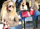 9.May.2016 - Beverly Hills Ò USA *** STRICTLY AVAILABLE FOR UK AND GERMANY USE ONLY *** Beverly Hills, CA - Khloe Kardashian visits Meche Salon today to get her hair done to start the week.  Khloe made sure to pay her parking meter and showed off her killer curves in a green bodysuit and skin tight jeans with knee high boots. BYLINE MUST READ : AKM-GSI-XPOSURE ***UK CLIENTS - PICTURES CONTAINING CHILDREN PLEASE PIXELATE FACE PRIOR TO PUBLICATION *** *UK CLIENTS MUST CALL PRIOR TO TV OR ONLINE USAGE PLEASE TELEPHONE 0208 344 2007*