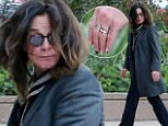 eURN: AD*205535365  Headline: Ozzy Osbourne hides beneath his hair as he steps out with one of his many dogs in LA amid reports that he and wife Sharon are splitting up after 33 years of marriage Caption: 151648, Ozzy Osbourne hides beneath his hair as he steps out with one of his many dogs in LA amid reports that he and wife Sharon are splitting up after 33 years of marriage. According to The Sun of London, Ozzy Osbourne and Sharon Osbourne are getting divorced after 33 years together because she believes he has been cheating on her with a much younger celebrity stylist Michelle Pugh. The pair split previously on their 32nd wedding anniversary due to drug and booze issues, but have reconciled after Ozzy received treatment for the abuse. Los Angeles, California - Monday May 9, 2016. Photograph: ¨© PacificCoastNews. Los Angeles Office: +1 310.822.0419 UK Office: +44 (0) 20 7421 6000 sales@pacificcoastnews.com FEE MUST BE AGREED PRIOR TO USAGE Photographer: PacificCoastNews  Loaded on 0
