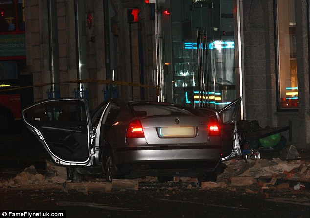 London Fire Brigade said the concrete fascia of the building collapsed on to the car