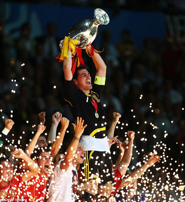 Medals: Casillas has won everything in the game and here he is lifting the Euro 2008 trophies