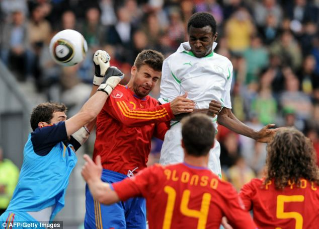 Challenge: Spain's Gerard Pique (centre) adds a touch of class and calm to the back four