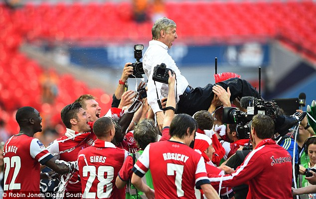 Celebrations: Arsene Wenger was given the bumps following Arsenal's FA Cup triumph on Saturday