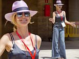 EXCLUSIVE: Heidi Klum taking selfies and dancing in flare jeans and purple sun hat while rehearsing for the final of Germany's Next Top Model in Palma de Mallorca, Spain. The German Supermodel had a picture of herself with children on her Apple iPhone case as she fooled around at historic bull ring - Plaza de Toros.\n\nPictured: Heidi Klum\nRef: SPL1280059  120516   EXCLUSIVE\nPicture by: Deano / Splash News\n\nSplash News and Pictures\nLos Angeles: 310-821-2666\nNew York: 212-619-2666\nLondon: 870-934-2666\nphotodesk@splashnews.com\n