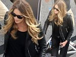 EXCLUSIVE Elle Macpherson smokes up the small screen in leather 4.JPG