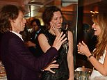CANNES, FRANCE - MAY 13:  (L to R) Sir Mick Jagger, Rebecca Hall and Jemima Khan attend The 8th Annual Filmmakers Dinner hosted by Charles Finch and Jaeger Le-Coultre at Hotel du Cap-Eden Roc on May 13, 2016 in London, England.  (Photo by David M. Benett/Dave Benett/Getty Images for Finch & Partners)