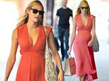 EXCLUSIVE: Candice Swanepoel seen wearing a peach dress with baby bump in New York City  Pictured: Candice Swanepoel Ref: SPL1280809  120516   EXCLUSIVE Picture by: Frank Sullivan/Splash News  Splash News and Pictures Los Angeles: 310-821-2666 New York: 212-619-2666 London: 870-934-2666 photodesk@splashnews.com