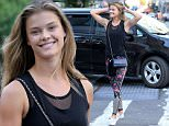 EXCLUSIVE: Model Nina Agdal, wearing a black tank top, colorful tights and a blue Chanel purse, walks to Soul Cycle in New York City on May 12, 2016.\n\nPictured: Nina Agdal\nRef: SPL1281129  120516   EXCLUSIVE\nPicture by: Christopher Peterson/Splash News\n\nSplash News and Pictures\nLos Angeles: 310-821-2666\nNew York: 212-619-2666\nLondon: 870-934-2666\nphotodesk@splashnews.com\n