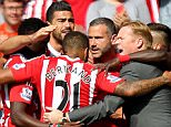 Graziano Pelle of Southampton celebrates scoring his sides second goal with the whole team and Manager Ronald Koeman during the Barclays Premier League match between Southampton and Crystal Palace played at St Mary's Stadium, Southampton on 15th May 2016