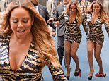 EXCLUSIVE TO INF.\nMay 16, 2016:  Mariah Carey arriving at the NBC Upfronts in New York City wearing a super short and extremely tight animal print sequin dress and fishnet stockings. Pictured here: Mariah nearly falls over as she twists her ankle in her extremely high platform heels.\nMandatory Credit: Elder Ordonez/INFphoto.com      Ref.: infusny-160