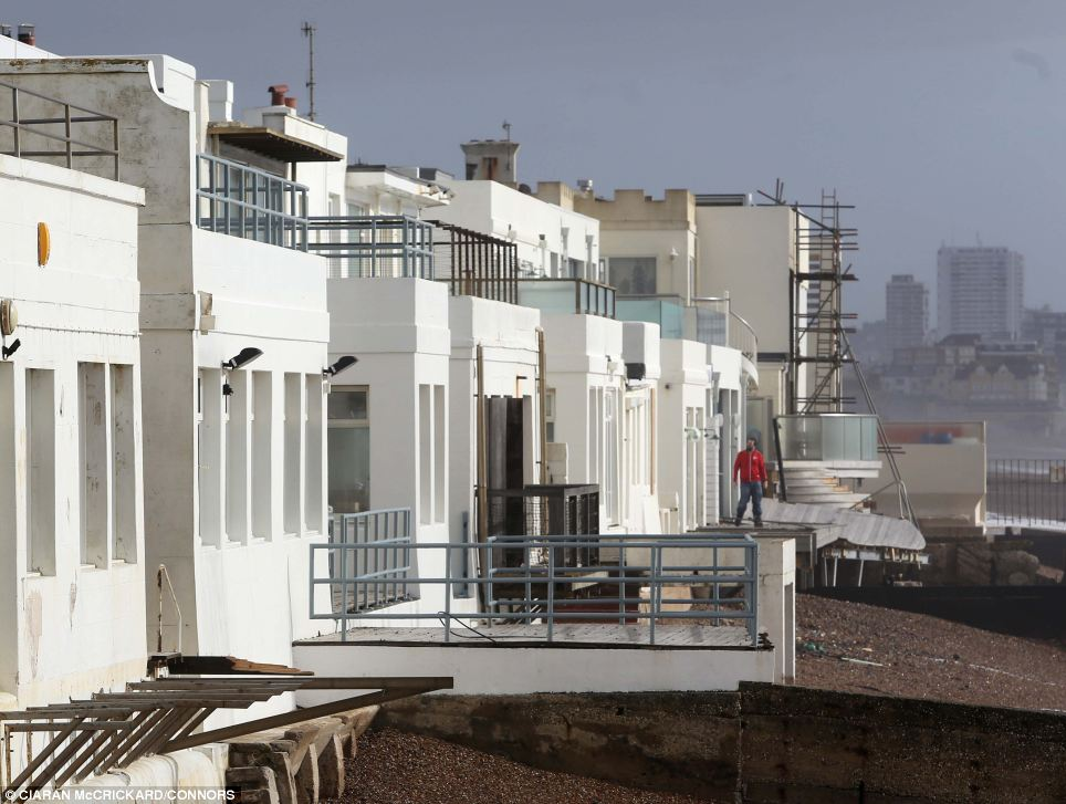 Homes facing Hove's seafront endured a night of howling wind and pounding waves as south England was battered by the ongoing storm