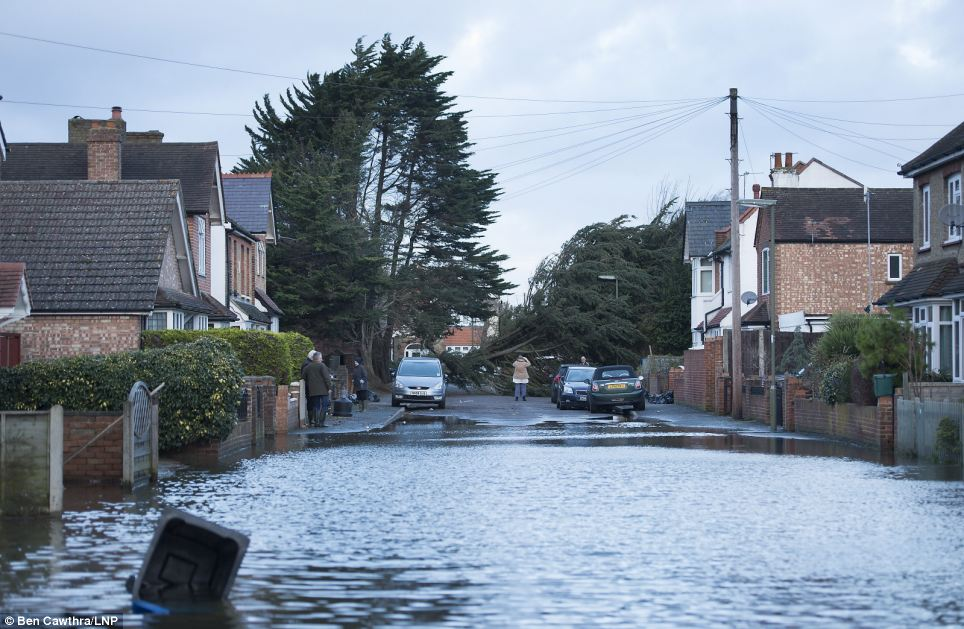 The south of England was battered again by strong winds and heavy rain last night, as thousands of homes were cut off from their power