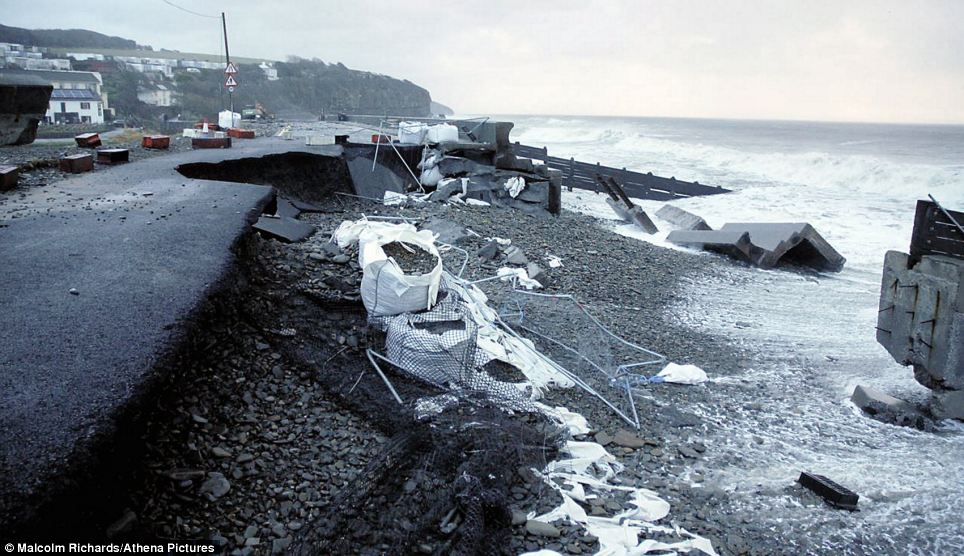 Further overnight major damage has been caused to a path in Amroth, west Wales, where parts of the road were ripped up