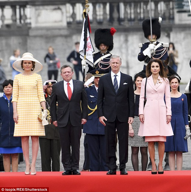 The royal party posed for an official party outside the palace in Brussels this morning
