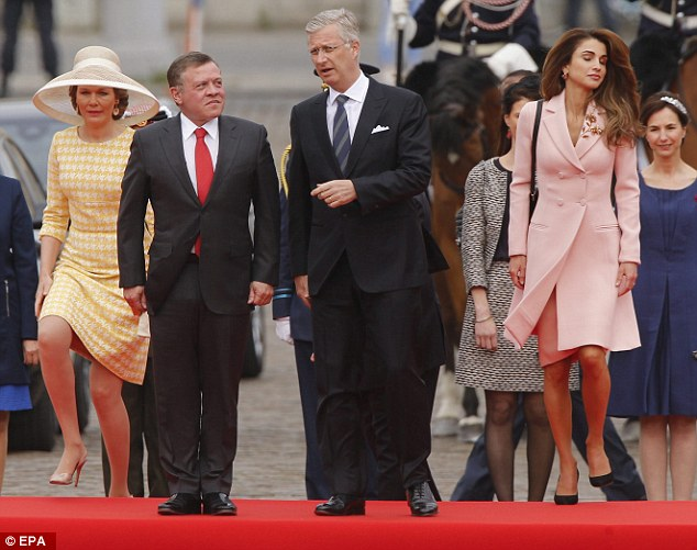 Jordan's King Abdullah II (left) and Belgium's King Philippe chatted as their wives caught up
